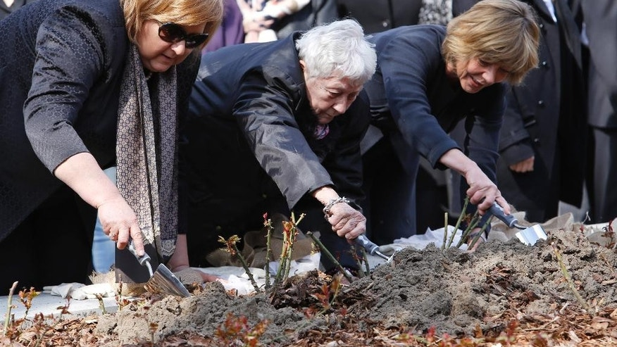 April 19, 2015: Poland's First Lady,  Anna Komorowska, Annette Chalut, camp survivor and President of the International Ravensbrueck Committee,  and Germany's  First Lady Daniela Schadt, from left, plant roses during an event at the former Nazi concentration camp Ravensbrueck in Fuerstenberg, northeastern Germany, to commemorate the 70th anniversary of the liberation of the camp by the Red Army on April 30, 1945.