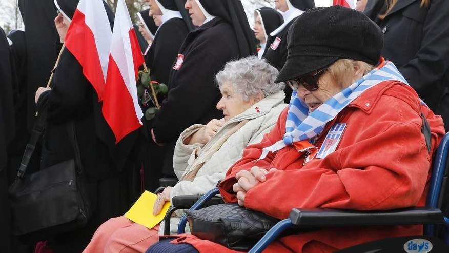 April 19, 2015: Camp survivors and Polish nuns pray the Angelus during  ceremonies  at the former Nazi concentration camp Ravensbrueck in Fuerstenberg, northeastern Germany, to commemorate the 70th anniversary of the liberation of the camp by the Red Army on April 30, 1945.