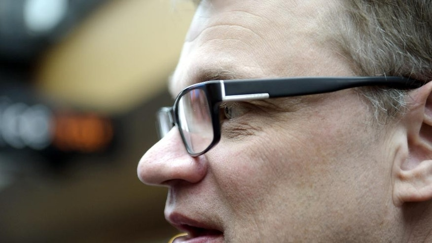 Chairman Juha Sipila of the Centre Party campaigns in Espoo, Finland, Saturday, April 18, 2015, ahead of the parliamentary elections on Sunday. Sunday's election comes against the backdrop of a three-year recession in a country that, typically, enjoys praise as one of the world's most competitive economies. Prime Minister Alexander Stubb is on the defensive as unemployment reaches a decade high of 10 percent and derelict storefronts become an increasingly common sight. (Vesa Moilanen/Lehtikuva via AP)  FINLAND OUT