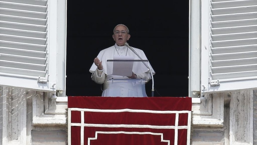 "Pope Francis delivers his speech from the window of his studio overlooking St. Peter's square during the Regina Coeli midday prayer, at the Vatican, Sunday, April 19, 2015. Referring to a boat crowded with migrants capsized in the sea north of Libya, Francis said:""There are fears there could be hundreds of dead"", then  he bowed his head in silent prayer as did many of the tens of thousands in the crowd. (AP Photo/Andrew Medichini)"