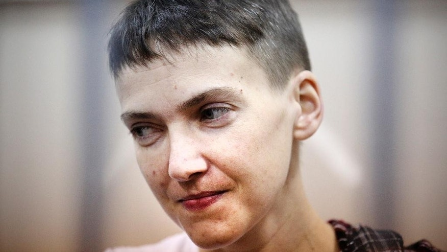 "FILE - In this March 26, 2015, file photo, Ukrainian jailed military officer Nadezhda Savchenko attends a court hearing in Moscow. Maria Shavchenko, the mother of a Ukrainian helicopter pilot imprisoned in Russia is on a global campaign seeking support from world leaders to pressure President Vladimir Putin to free her daughter, Nadezhda Savchenko. Maria Shavchenko said in an interview with The Associated Press on Monday, April 20, 2015, that her daughter is a political prisoner and Russian prosecutors have provided ""no evidence"" that she provided guidance for a mortar attack that killed two Russian state TV journalists at a checkpoint in eastern Ukraine, as Moscow claims.  (AP Photo/Maxim Chernavsky, File)"
