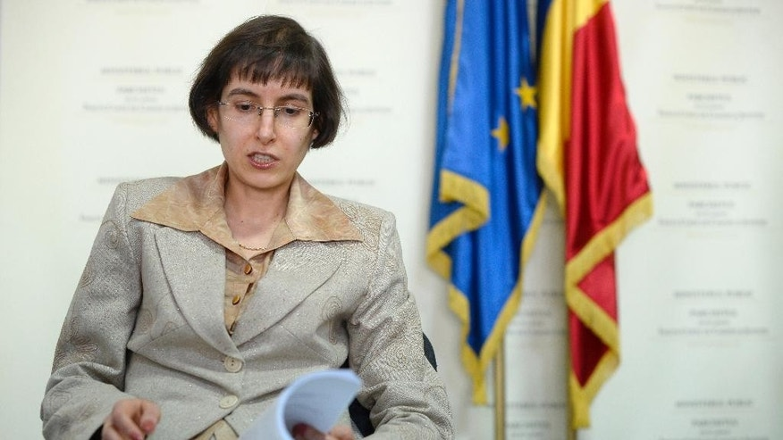 In a picture taken on Friday, Feb. 20, 2015 Prosecutor Denisa Cristodor, speaks during an interview with the Associated Press in Bucharest, Romania. Under communism, the justice system was a man's domain; in the 1990s, with the advent of democracy and capitalism in Romania, men left poorly paying state prosecutor and magistrate jobs and the result is that 60 percent of Romania's prosecutors and judges today are women.(AP Photo/Octav Ganea, Mediafax) ROMANIA OUT