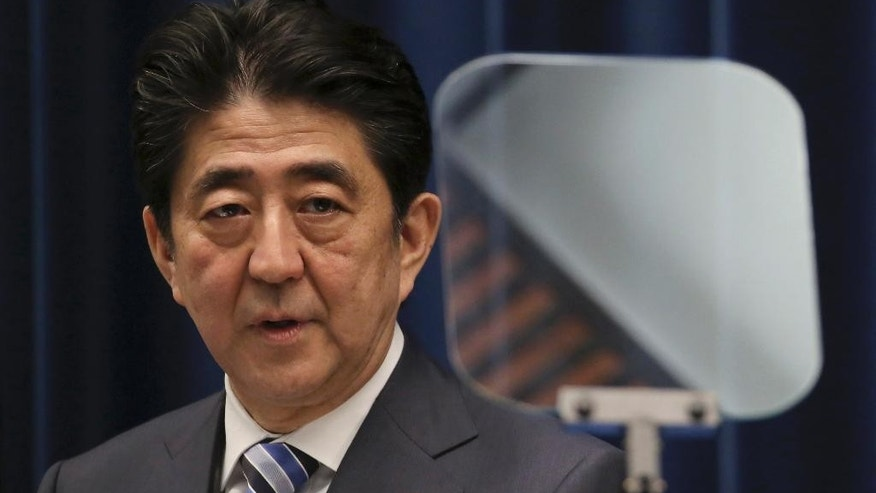 FILE - In this March 10, 2015 file photo,  Japanese Prime Minister Shinzo Abe delivers a speech during a press conference at his official residence in Tokyo on the eve of the fourth anniversary of the March 11, 2011 earthquake and tsunami. Abe has sent religious offerings to a Tokyo shrine that honors convicted World War II leaders among its war dead. But Abe's offerings on Tuesday, April 21, 2015 signal that he will not pray at the controversial Yasukuni shrine ahead of trips to Asia and the United States. (AP Photo/Eugene Hoshiko, File)