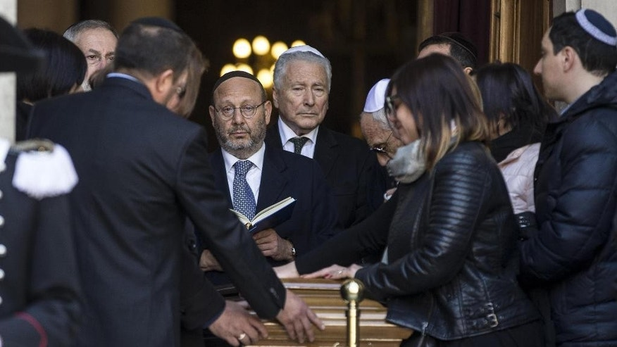 The president of the Roman Jewish community Riccardo Pacifici reads from a book as the coffin of Rome's former chief Rabbi Elio Toaff is carried into Rome's Synagogue, Monday, April 0, 2015. Rabbi Elio Toaff died in Rome Sunday, April 19, 2015 at the age of 99. (Massimo Percossi/ANSA via AP) ITALY OUT