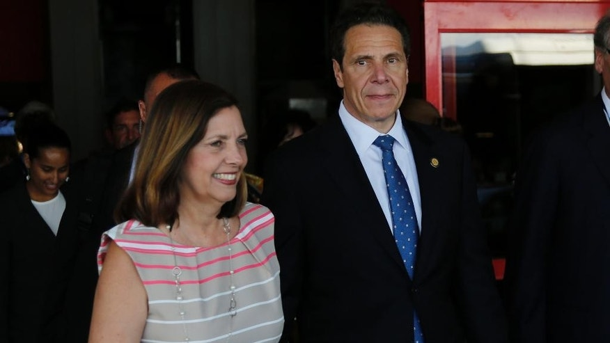 New York Governor Andrew Cuomo, right, walks with Cuba's Josefina Vidal, director general of the U.S. division at Cuba's Foreign Ministry, as he arrives to the Jose Marti airport in Havana, Cuba, Monday, April 20, 2015. Cuomo is the first U.S. governor to visit Cuba since the Dec. 17 declaration of detente. (AP Photo/Desmond Boylan)