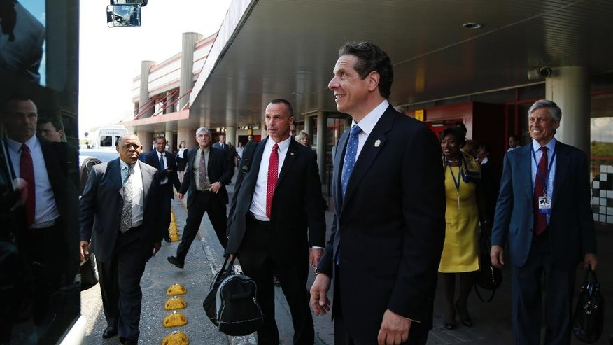 New York Governor Andrew Cuomo prepares to board a bus provided for his delegation after arriving to Jose Marti airport in Havana, Cuba, Monday, April 20, 2015. Cuomo is the first U.S. governor to visit Cuba since the Dec. 17 declaration of detente. (AP Photo/Desmond Boylan)
