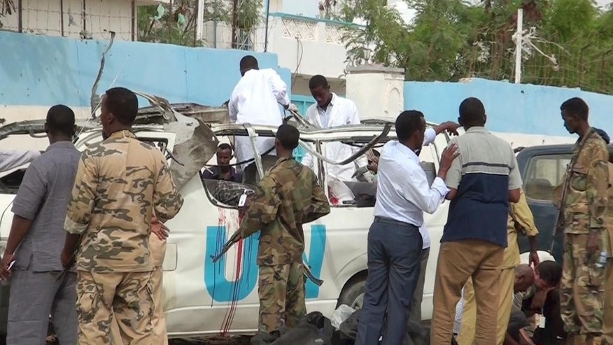 This image made from video shows the scene following a bomb attack on a van carrying U.N. employees in Garowe, in the semiautonomous Puntland region of northern Somalia Monday, April 20, 2015. A bomb exploded Monday in northern Somalia, killing at least 10 people and wounding many others, police and U.N. officials said, with the al-Qaida-linked al-Shabab group claiming responsibility for the attack, according to the group's Andalus radio. (AP Photo)