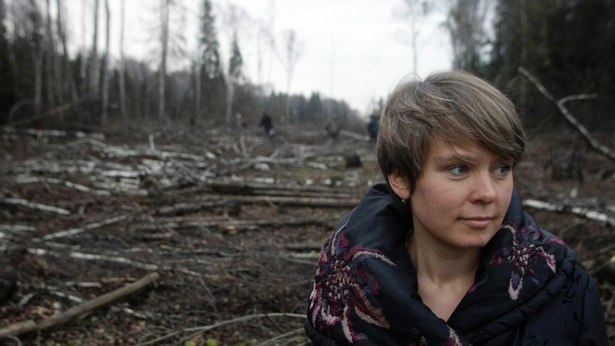 FILE - In this Wednesday Nov. 10, 2010 file photo environmental activist Yevgenia Chirikova stands in the clearing, in the Khimki forest north of Moscow, Russia. Yevgenia Chirikova, prominent environmentalist told the Associated Press on Monday, April 20, 2015, that she had fled Russia, moving with her family to Estonia out of fear that government harassment could take her children away from her.  Yevgenia Chirikova in 2010 mounted Russia's biggest environmental campaign at the time, opposing the construction of a highway outside Moscow which was pushed by some of the country's most powerful people. (AP Photo/Mikhail Metzel, file)