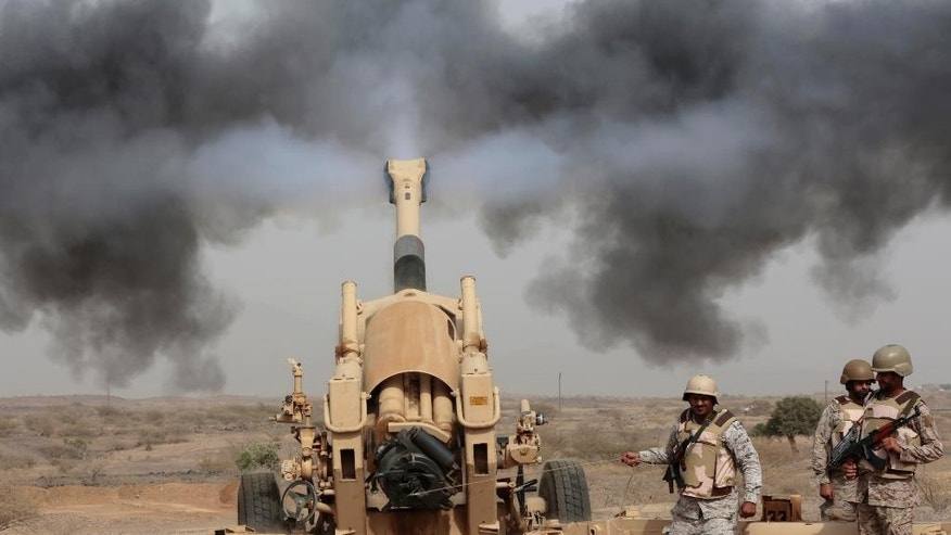 Saudi soldiers fire artillery toward three armed vehicles approaching the Saudi border with Yemen in Jazan, Saudi Arabia, Monday, April 20, 2015. The Saudi air campaign in Yemen is now in its fourth week. (AP Photo/Hasan Jamali)