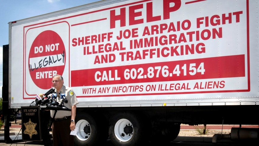 FILE - In this July 29, 2010 file photo, Maricopa County Sheriff Joe Arpaio gives a news conference in Phoenix announcing crime suppression sweeps. As frustrations mounted a decade ago over illegal immigration, Arpaio created an elite squad to crack down on smugglers and, in the process, became known across the country as a tough-talking lawman willing to step in where the federal government wouldnât. But the now-disbanded squad has turned into an ever-worsening legal liability, the thorniest one that he has faced in his 22 years as Maricopa County sheriff. A judge will hold hearings beginning Tuesday, April 21, 2015 over whether to hold the sheriff and the squad's leader in contempt of court for letting Arpaio's immigration patrols continue for about 18 months after a court found that his office racially profiled Latinos and ordered that they be stopped.(AP Photo/Matt York, File)