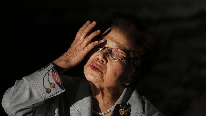 In this March 22, 2015 photo, Yoshiko Shimabukuro, a survivor of the Himeyuri Student Nurse Corps 70 years ago, speaks on her experience of the battle of Okinawa during WWII at an interview with The Associated Press at Himeyuri Peace Museum in Itoman on the southern Japanese island of Okinawa. Shimabukuro, head of the museum, who experienced the war's darkest moments, it's never been easy to reconcile the hatred of the past with the peace of the present. It took decades for Baker to open up about his experiences. Shimabukuro has spent her life teaching children the horrors of her personal battle and praying for the day when the 20,000 U.S. troops still based on her island will leave, once and for all. (AP Photo/Eugene Hoshiko)