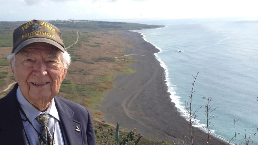 In this March 21, 2015 photo provided by Norman Baker, Baker of Delaplane, Va., smiles atop Mount Suribachi on Iwo Jima after attending a memorial for the 70th anniversary of the battle of Iwo Jima. This year marks the 70th anniversary of World War II, the bloodiest and most all-encompassing war in the history of mankind. Japan and the United States, once the bitterest of enemies, are now among the closest of allies. For Baker, who experienced the war's darkest moments, it's never been easy to reconcile the hatred of the past with the peace of the present. Baker arrived with the 4th Marine Division on Iwo Jima in the dead of night on Feb, 25, 1945, a last-minute replacement to his battalion of Seabees, with no construction experience. He was assigned to a security detachment protecting units clearing two airfields, the first near Mount Suribachi - scene of the iconic U.S. flag-raising. (Courtesy of Norman Baker via AP)