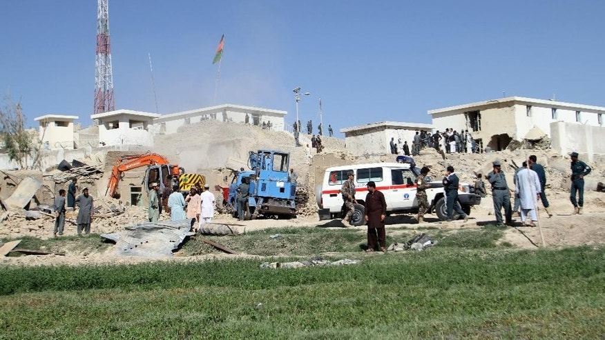 Afghan security forces work at the site of a bombing in Kandahar, south of Kabul, Afghanistan, Tuesday, April 21, 2015. Afghan officials say an explosion near a police station has killed several people and wounded over a dozen. Samim Khpalwak, spokesman for the provincial governor, said the explosion Tuesday morning struck the city of Kandahar, the capital of Kandahar province. Authorities initially believed a car bomb caused the explosion, but later said they were unsure what happened. (AP Photo)