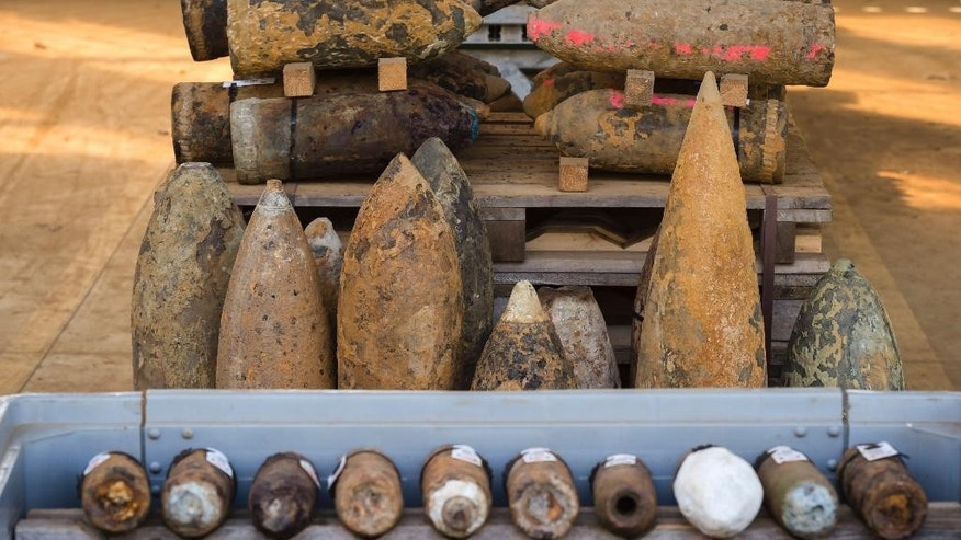 "World War I shells, some colored in pink are suspect gas shells, are piled in a warehouse at the explosive disposal facility (DOVO) in Poelkapelle, Belgium on Tuesday, April 21, 2015. Nearly 100 years since the first gas attacks in WWI, farmers and local land owners still find ammunition in what has locally been called the ""Iron Harvest"". (AP Photo/Geert Vanden Wijngaert)"