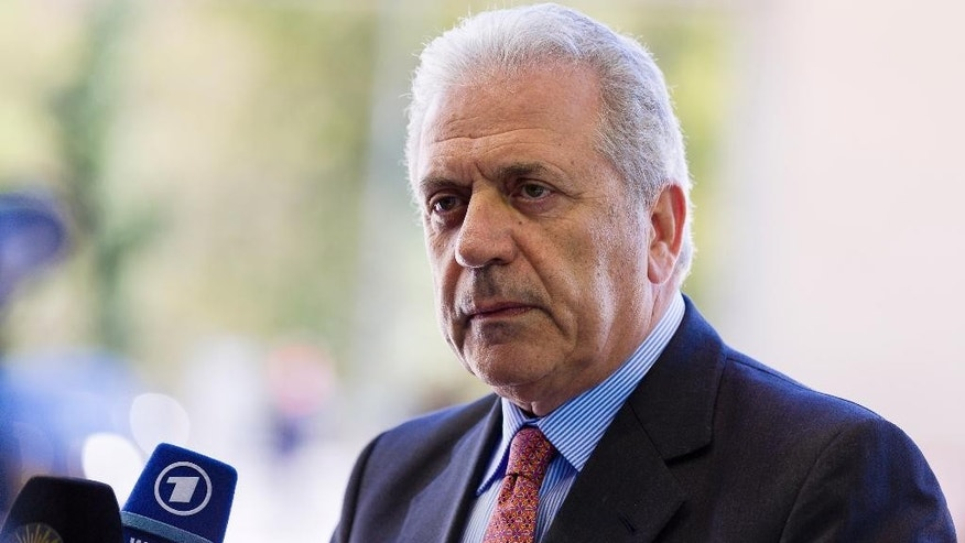 European Commissioner for Migration and Home Affairs Dimitris Avramopoulos speaks with the media as he arrives for a meeting of EU foreign ministers at the EU Council building in Luxembourg on Monday, April 20, 2015. An Italian coast guard ship headed toward Sicily Monday to look for survivors of a capsized ship in what could be the Mediterranean's deadliest migrant tragedy, as EU foreign ministers gathered for an emergency meeting to discuss the crisis. (AP Photo/Thierry Monasse)