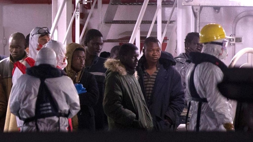 April 20, 2015: Survivors of the boat that overturned off the coasts of Libya Saturday, wait to disembark from Italian Coast Guard ship Bruno Gregoretti, at Catania Harbor, Italy.