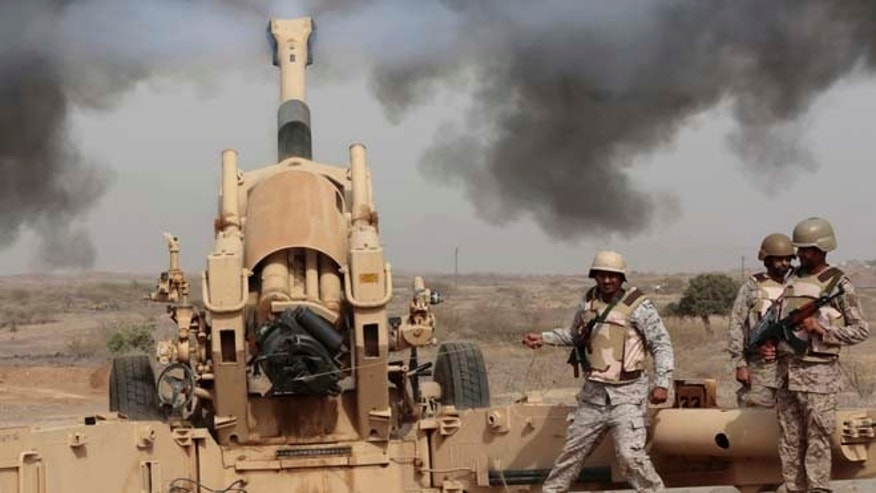 April 20, 2015: Saudi soldiers fire artillery toward three armed vehicles approaching the Saudi border with Yemen in Jazan, Saudi Arabia. The Saudi air campaign in Yemen is now in its fourth week.