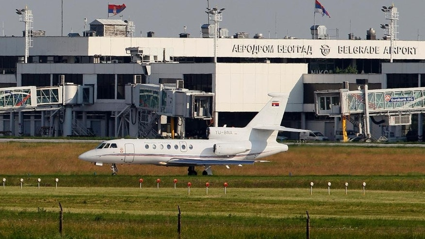 In this file photo taken May 31, 2011, a Serbian government Falcon plane prepares for take off at a Belgrade International Airport, Serbia. An investigation shows that a sudden plunge of the Serbian president's plane last week which triggered panic among passengers and an emergency return to Belgrade was caused by the co-pilot who spilled coffee on the instruments panel. (AP Photo/Darko Vojinovic, File)