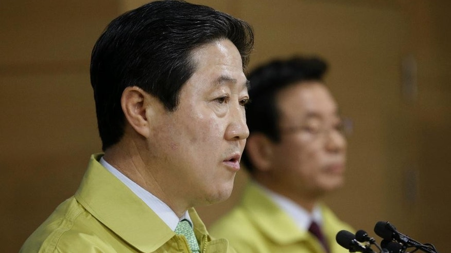 South Korean Oceans and Fisheries Minister Yoo Ki-june, left, speaks during a press conference as Public Safety and Security Minister Park In-yong listens at the government complex in Seoul, South Korea, Wednesday, April 22, 2015. South Korea on Wednesday formally approved plans to salvage the ferry Sewol that sank last year, meeting demands made by bereaved families wanting details about the cause of the sinking and the recovery of bodies of nine people still missing. The disaster killed more than 300 people, mostly high school students on a trip to a resort island. (AP Photo/Ahn Young-joon)