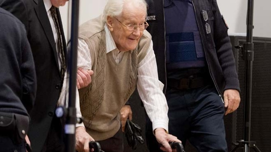 April 21, 2015: Defendant Oskar Groening arrives in the court room in Lueneburg, northern Germany.