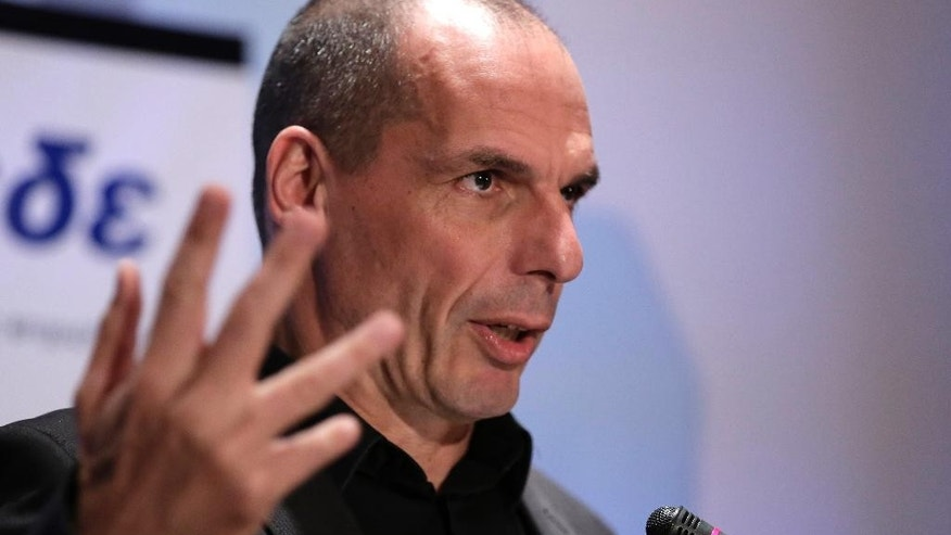 Greek Finance Minister Yanis Varoufakis gives a speech during a banking conference in Athens, on Tuesday, April 21, 2015. Greek local authorities were on the brink of revolt Tuesday against the central government's move to use cash reserves from state agencies — including hospitals and kindergartens — to help the country make ends meet.(AP Photo/Petros Giannakouris)