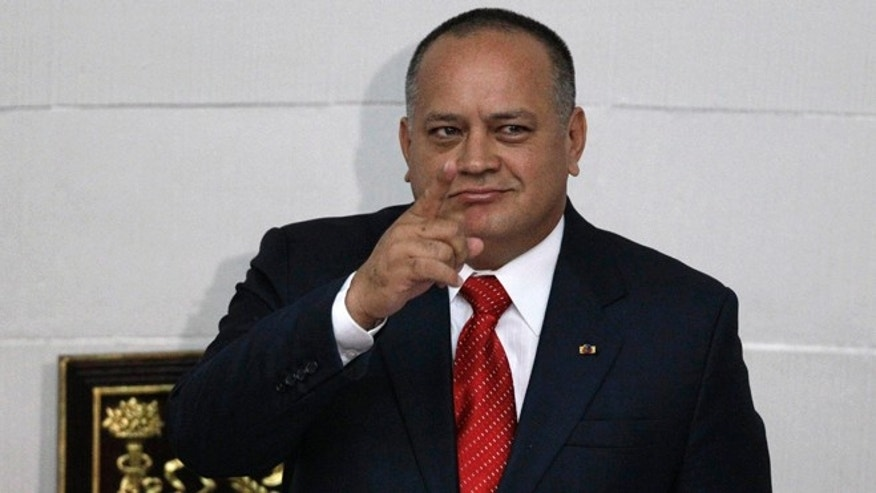 FILE - In this Jan. 5, 2013, file photo, National Assembly President Diosdado Cabello gestures before addressing the National Assembly in Caracas, Venezuela.  Cabello said Tuesday, April 22, 2015, that he will file a lawsuit against the outlets that published reports in January saying his bodyguard had defected to the United States to testify that his former boss heads a drug ring of political and military officials. (AP Photo/Ariana Cubillos, File)