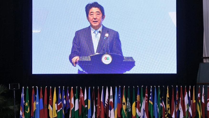 Japanese Prime Minister Shinzo Abe delivers his speech during a plenary session at the Asian African Summit in Jakarta, Indonesia, Wednesday, April 22, 2015. (Beawiharta/Pool Photo via AP)