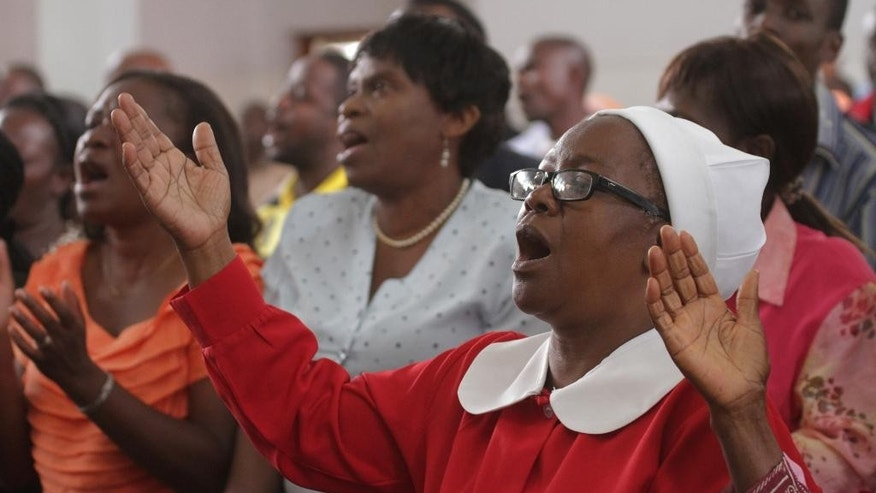 Zimbabweans worship, during an anti immigrant attack prayer session at the Trinity Methodist church in Harare, Wednesday, April, 22, 2015. The prayer session which was organised  by the  Zimbabwe Heads of  Christian Denominatons and Civil Society Organisations, comes in the wake of attacks on foreign immigrants which included Zimbabweans  living in neighbouring South Africa. (AP Photo/Tsvangirayi Mukwazhi)
