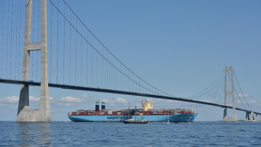 """FILE - A Tuesday Aug. 20, 2013 photo from files showing the container ship, the Maersk Mc-Kinney Moller, as it passes below the Storebaelts Bridge, Denmark, on the last kilometer of it's maiden voyage. Bound by the laws of the sea to help seafarers in distress, shipping companies say Europe's migration crisis has placed unreasonable demands on their crews to act as lifesavers in the Mediterranean. """"We place people on deck where there is room, we can give them some first aid and food but that is it,"""" said Steffen Conradsen, risk manager at Maersk Line, the world's biggest shipping company. (Per Rasmussen/Polfoto via AP, File)   DENMARK OUT"""