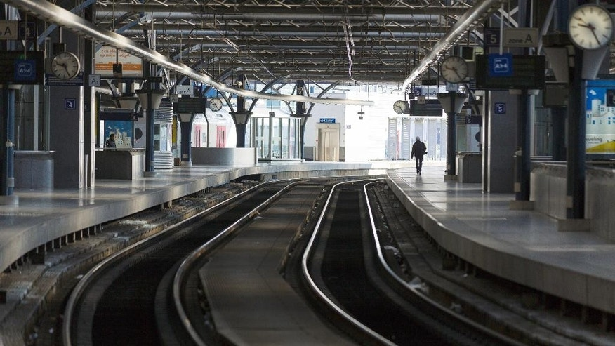 A man walks down an empty platform at Brussels Midi Station during a train strike on Wednesday, April 22, 2015. Both Eurostar and Thalys international trains were affected by the strike as well as local Belgian train service. (AP Photo/Thierry Monasse)
