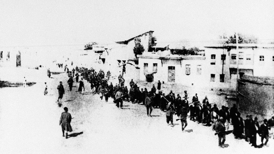 "FILE - In this 1915 file photo, Armenians marched long distances and said to have been massacred in Turkey. The Nazi genocide of European Jews is widely commemorated in Israel and etched deeply into the psyche of a country founded in its aftermath. But when it comes to the mass killing of Armenians by Ottoman Turks during World War I, which historians have called the ""first genocide of the 20th century,"" Israel has largely stayed silent. Fearing repercussions from its former ally Turkey and wary of breaking ranks with American policy, Israel has refrained from calling the mass killings a genocide. (AP Photo, File)"