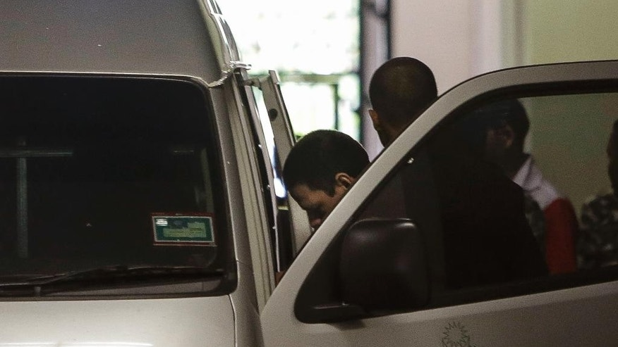 Jose Regino, third from right, and Luis Alfonso Gonzalez, right in white, two of three Mexican brothers convicted of manufacturing drugs, are taken into a prison van at appeals court in Putrajaya, Malaysia, Thursday, April 23, 2015. The court upheld a decision to sentence the three Mexican brothers to death for drug related offences. The three were arrested in March 2008 at a factory in southern Malaysia where police found 30 kilograms (66 pounds) of methamphetamine worth US$15 million and equipment to make drugs. (AP Photo/Joshua Paul) The ruling was made following an appeal by the defence team representing the three men. After the ruling, head defence lawyer Hisham the said that they will seriously consider filing for a judicial review in the case. (AP Photo/Joshua Paul)