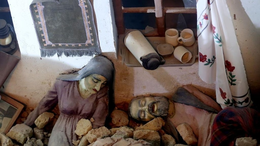 This Sunday, April 12, 2015 photo, shows statues depicting civilian casualties of clashes between the Soviet army and Mujahideen, at the Jihad Museum in Herat city, west of capital Kabul, Afghanistan. Despite being an obvious homage to victory over the Soviet Union, the museum's creators say it does not seek to glorify war. The goal, they insist, is to preserve the memories of sacrifice and cruelty so future generations can avoid the painful mistakes of their forefathers. (AP Photo/Massoud Hossaini)