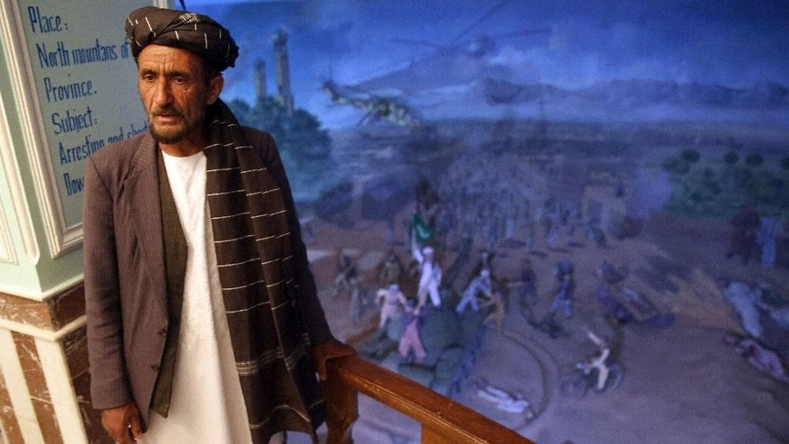 In this Sunday, April 12, 2015 photo, tour guide Sayed Hassan, speaks during an interview with The Associated Press, at the Jihad Museum, in Herat city, west of capital Kabul, Afghanistan. Despite being an obvious homage to victory over the Soviet Union, the museum's creators say it does not seek to glorify war. The goal, they insist, is to preserve the memories of sacrifice and cruelty so future generations can avoid the painful mistakes of their forefathers. (AP Photo/Massoud Hossaini)