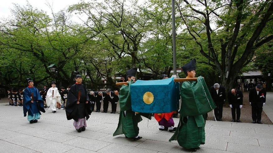 The Imperial envoys visit the Yasukuni Shrine, delivering a gift from the emperor for an annual spring festival in Tokyo Wednesday, April 22, 2015. (AP Photo/Shizuo Kambayashi)