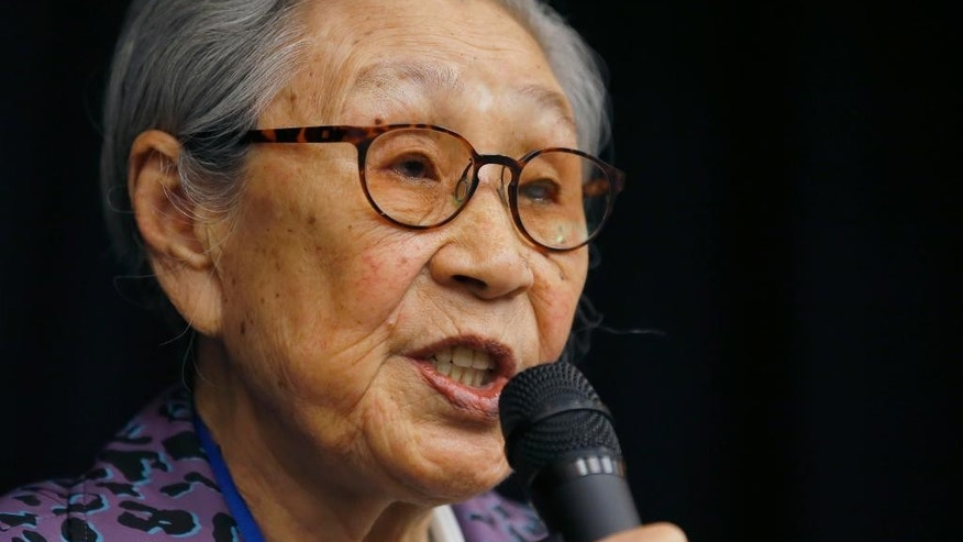"Kim Bok-tong, 88, a South Korean woman who was one of the sex slaves in Japan's military brothels during the war, speaks during a symposium in Tokyo Thursday, April 23, 2015. ""I hope Abe truly acknowledges and regrets Japan's past mistakes and resolves the problem before we all die,"" said Kim. She also appealed to the U.S. government ""to correct Abe's actions and not support him. That's what America should be doing to its good friend.""  (AP Photo/Shizuo Kambayashi)"