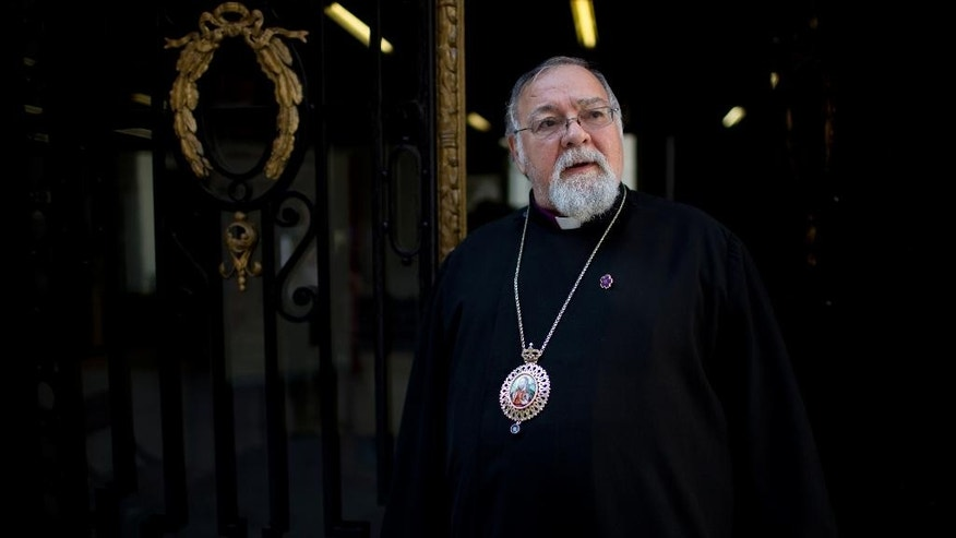 "The head of the Armenian Apostolic Church in Argentina, Archbishop Kissag Mouradian, stands outside the Armenian church in Buenos Aires, Argentina, Wednesday, April 22, 2015. The maximum authority of the Armenian Apostolic Church in Argentina says he is proud, but definitely not surprised, that his friend Pope Francis recently called the 1915 massacre of Armenians in Turkey ""genocide."" (AP Photo/Natacha Pisarenko)"