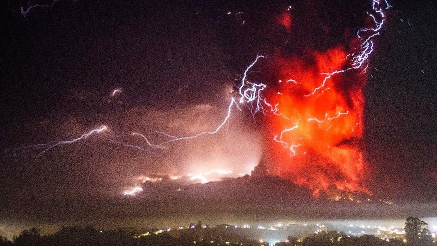 The Calbuco volcano erupts near Puerto Varas, Chile, Thursday, April 23, 2015. The volcano erupted Wednesday for the first time in more than 42 years, billowing a huge ash cloud over a sparsely populated, mountainous area in southern Chile, and is considered one of the top three most potentially dangerous among Chile's 90 active volcanos.(AP Photo/David Cortes Serey/ Agencia Uno) CHILE OUT - NO USAR EN CHILE