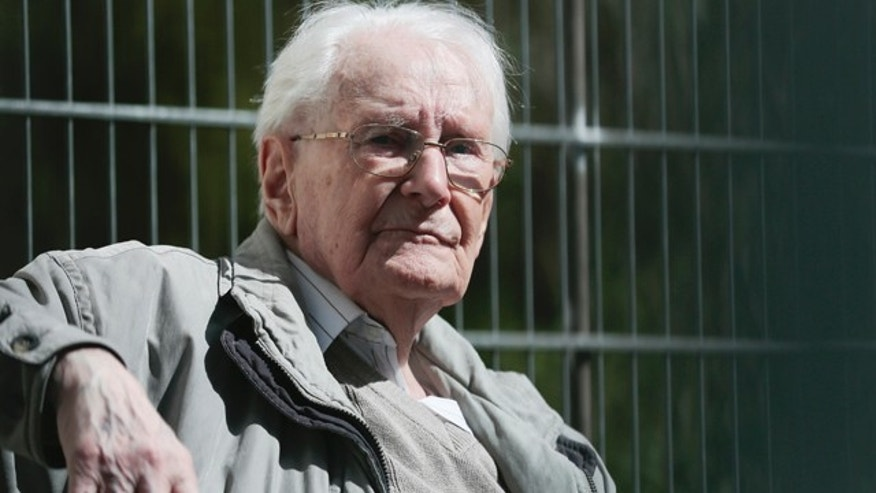April 21, 2015: Former SS guard Oskar Groening sits in ths sun during the noon break of the trial against him in Lueneburg, northern Germany.  Groening, 93, faces 300,000 counts of accessory to murder at the trial, which will test the argument that anyone who served as a guard at a Nazi death camp was complicit in what happened there. (AP Photo/Markus Schreiber)