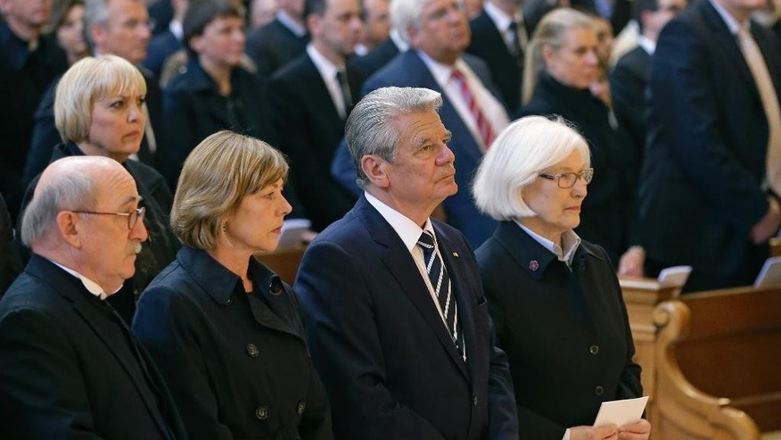 German President Joachim  Gauck, third left, and his partner Dabiela Schadt, second left, attend an ecumenical service remembering the Armenian slaughter at the Berlin Cathedral Church in Berlin, Germany, Thursday, April 23, 2015. On Friday, April 24, Armenians will mark the centenary of what historians estimate to be the slaughter of up to 1.5 million Armenians by Ottoman Turks, an event widely viewed by scholars as genocide. Turkey, however, denies the deaths constituted genocide and says the death toll has been inflated.  (AP Photo/Michael Sohn)