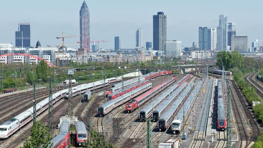 Passenger trains are parked at the main train station in Frankfurt, central Germany, Wednesday, April 22, 2015. The GDL union said passenger services will be hit from 2 a.m. (00:00 GMT) Wednesday until 9 p.m. (19:00 GMT) Thursday. (Boris Roessler/dpa via AP)