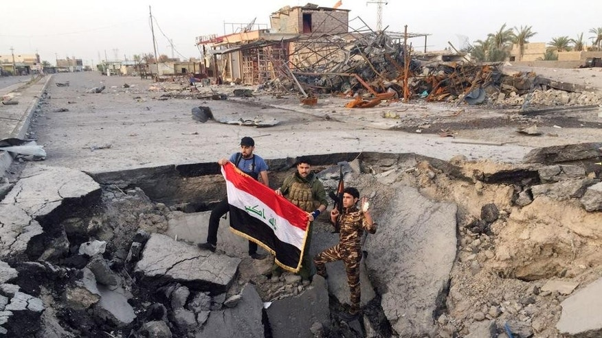 Iraqi security forces and tribal fighters regain control of the Northern neighborhoods after overnight heavy clashes with militants from the Islamic State group in Ramadi, 70 miles (115 kilometers) west of Baghdad, Iraq, Thursday, April 23, 2015. In the two weeks since militants from the Islamic State group overran central Ramadi, thousands of people have streamed out of the city, fleeing the brutal clashes between the extremists and Iraqi security forces.  (AP Photo)