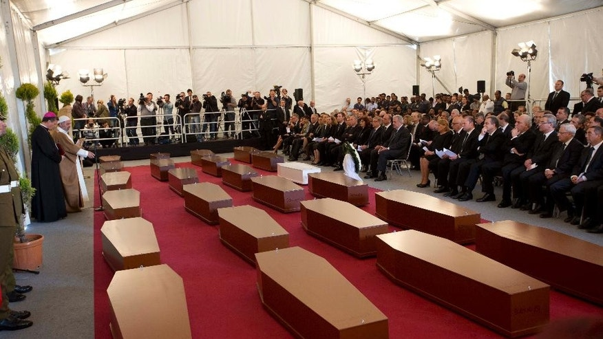 A view of the tent where a funeral service for 24 migrants drowned while trying to reach the Southern coasts of Italy took place, in Msida, in the outskirts of Valletta,  Malta, Thursday, April 23, 2015. The migrants died as a smuggler's boat crammed with hundreds of people overturned off the coast of Libya on Saturday as rescuers approached, causing what could be the Mediterranean's deadliest known migrant tragedy. (AP Photo/Alessandra Tarantino)