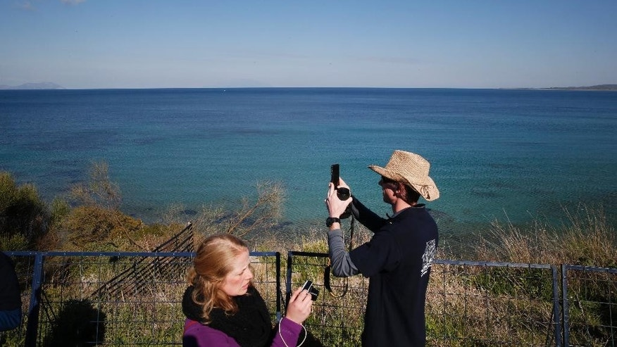 Australian visitors take pictures at the Anzac Cove beach in Gallipoli peninsula, Turkey, Thursday, April 23, 2015. Anzac Cove is a small cove on the Gallipoli peninsula and the site of World War I landing of the ANZACs (Australian and New Zealand Army Corps) on April, 25, 1915. As world leaders gather with the descendants of the fighters in Gallipoli, the memories of one of the most harrowing campaigns of the 20th century have come surging back to life. The doomed Allied offensive to secure a naval route from the Mediterranean to Istanbul through the Dardanelles, and take the Ottomans out of the war, resulted in over 130,000 deaths on both sides. (AP Photo/Lefteris Pitarakis)
