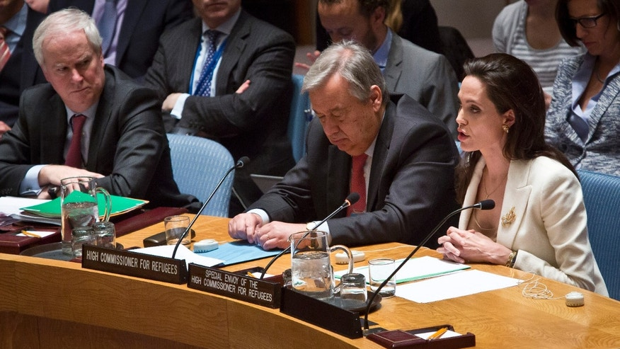 April 24, 2015 - UN High Commissioner for Refugees António Guterres, ctr, and British UN ambassador Mark Grant, left, listens as UN Special Envoy for Refugees Angelina Jolie , right, briefs the UN Security Council on Syria's refugee crisis.