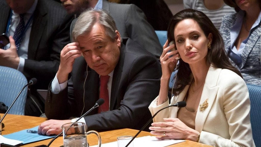 U.N. Special Envoy for Refugees and Hollywood star Angelina Jolie, right, and U.N. High Commissioner for Refugees António Guterres, left, brief the U.N. Security Council on Syria's refugee crisis, Friday, April 24, 2015. (AP Photo/Bebeto Matthews)