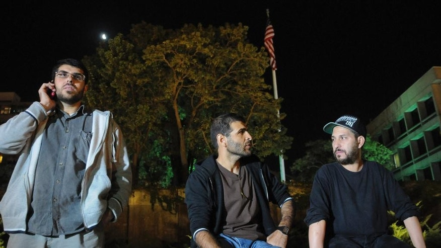 Three freed Guantanamo Bay detainees, who were resettled in Uruguay, protest outside the U.S. embassy in Montevideo, Uruguay, Friday, April 24, 2015. From left are Omar Abdelahdi Faraj and Ali Husain Shaaban, both of Syria, and Adel bin Muhammad El Ouerghi, of Tunisia. The men are protesting after they were asked to leave a hotel where some stayed periodically, and demand Washington help them financially. They say the house where they were initially resettled didn't have enough space for all of them. The men spent 12 years at the U.S. military prison but were never charged and released after officials determined they were no longer a threat. (AP Photo/Nicolas Garrido) URUGUAY OUT - NO PUBLICAR EN URUGUAY