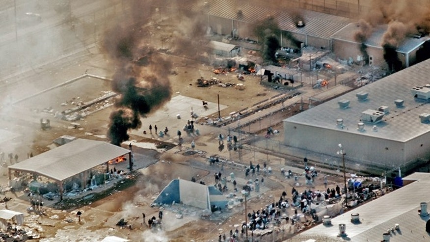"FILE - In this Thursday, Feb. 5, 2009 file photo, plumes of smoke rise from the yard and recreation building of Reeves County Detention Center 1 unit in Pecos, Texas. The fires came five days after inmates set fires to other parts of the RCDC I and II units during a riot blamed on complaints about inadequate health care and food. A Justice Department Inspector General report released Thursday, April 23, 2015, was critical of the operation at the the 2,400-bed facility that primarily houses ""low-level"" immigrants in the country illegally. (AP Photo/Pecos Enterprise, Smokey Briggs, file)"