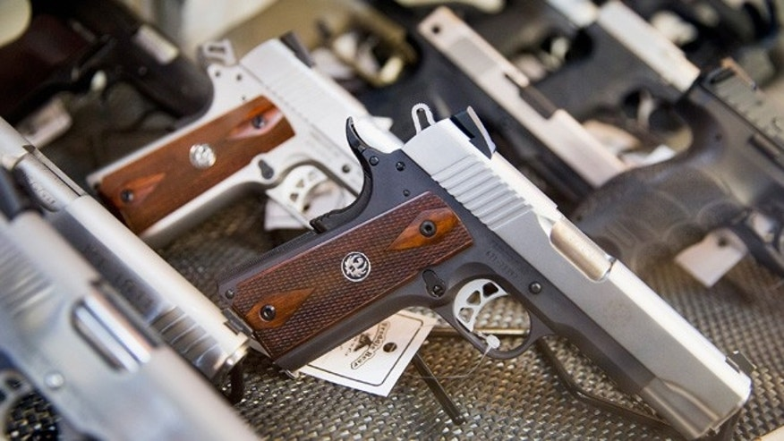 TINLEY PARK, IL - MARCH 11:  Handguns are offered for sale at Freddie Bear Sports on March 11, 2015 in Tinley Park, Illinois. According to a survey conducted by the University of Chicago 32 percent of Americans own guns, down from a high of 50 percent of the population in the 1970s and early 1980s.  (Photo by Scott Olson/Getty Images)