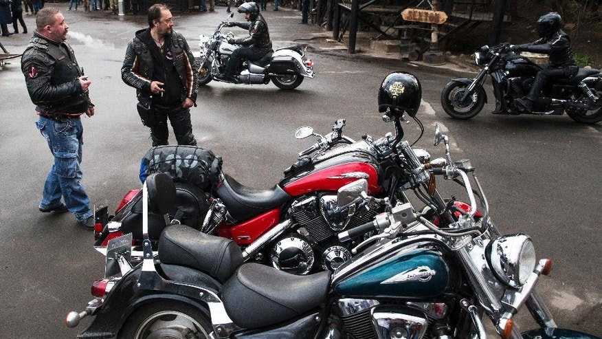 Russian Night Wolves biker club members arrive for a concert in Moscow, Russia, Thursday, April 23, 2015. The Night Wolves, a nationalistic group loyal to Russian President Vladimir Putin, are leaving Moscow on Saturday to ride through  Belarus and Poland on a journey to Berlin to mark the 70th anniversary of the Soviet victory over Nazi Germany. Bikers of the Night Wolves plan to retrace the westward path that Red Army soldiers took across eastern Europe as they fought Nazi troops. (AP Photo/Pavel Golovkin)